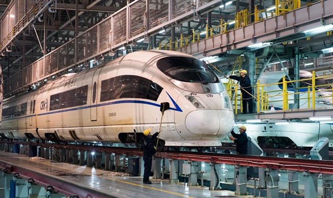 Workers check bullet trains before Spring Festival travel rush