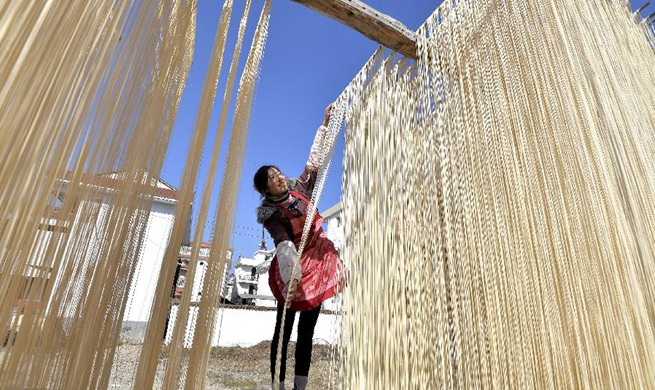 Villagers make handmade traditional dried noodles in China's Shaanxi