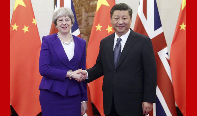 Xi meets May, calling for better Sino-British ties in new era