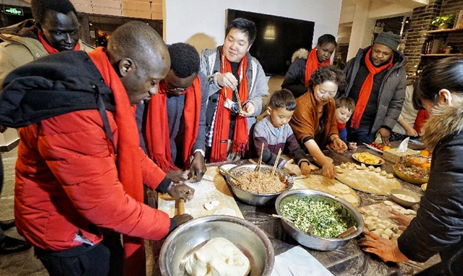 Foreigners participate in cultural event to greet Chinese New Year in Beijing