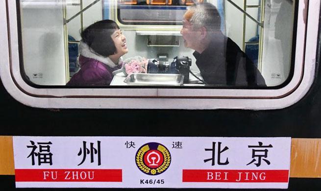 Trips on train from southeast China's Fuzhou to Beijing
