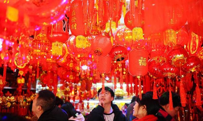 People make preparations to celebrate Spring Festival