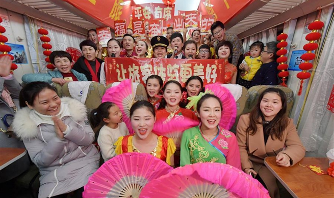 Attendants perform for passengers on train to celebrate Spring Festival