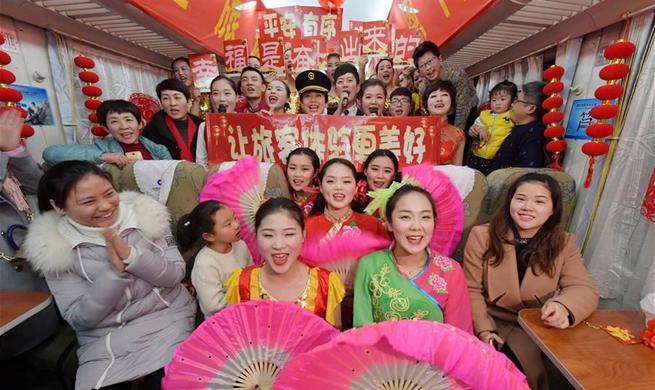Attendants perform for passengers on train to celebrate Spring Festival