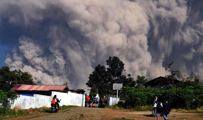 Indonesia volcano erupts, producing columns of ash