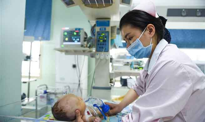 Doctors, nurses of neonatology department on call during Spring Festival in SW China