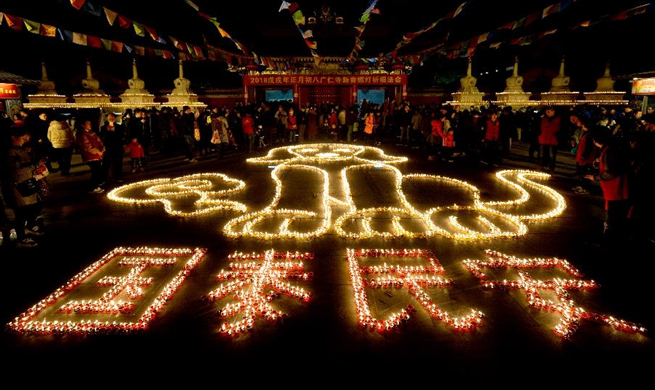 Citizens, tourists light butter lamps in NW China to express good wishes