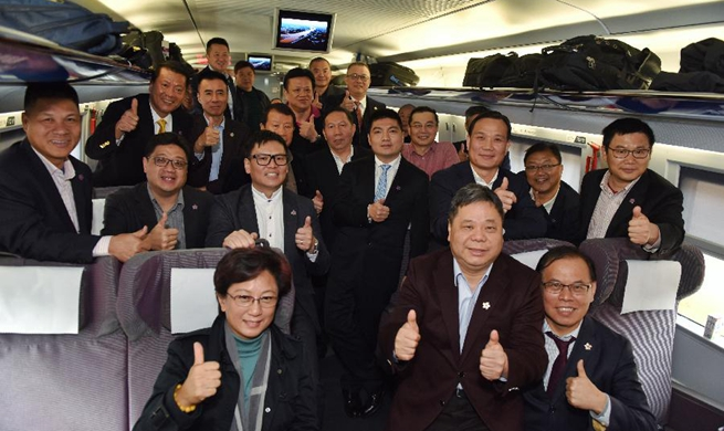 "NPC deputies, CPPCC members from HK arrive in Beijing for annual ""two sessions"""