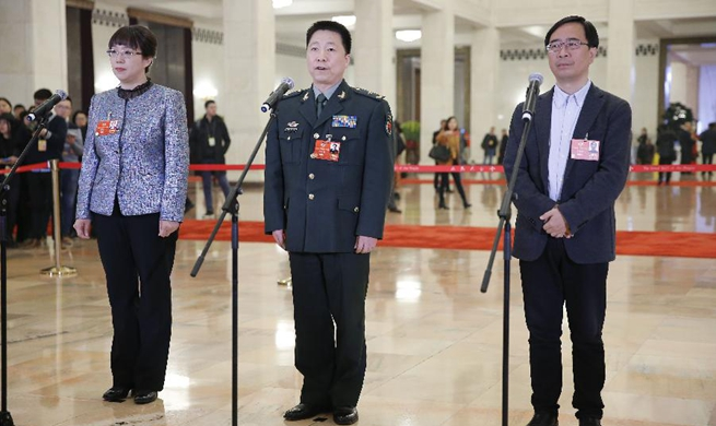 CPPCC members receive interview ahead of opening of annual session