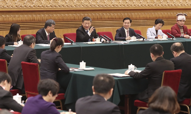 Chinese leaders join national legislators in panel discussions
