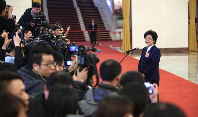 Ministers receive interview after second plenary meeting of first session of 13th NPC