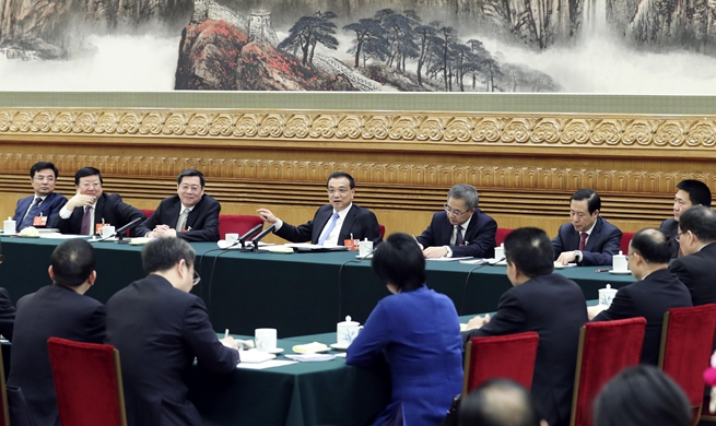 Chinese leaders join panel discussions at NPC session