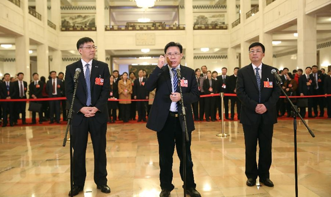 Deputies receive interview before 4th plenary meeting of 1st session of 13th NPC