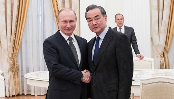 Russian President Putin meets with Wang Yi in Moscow