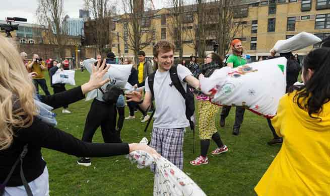 People have fun on Int'l Pillow Fight Day in London