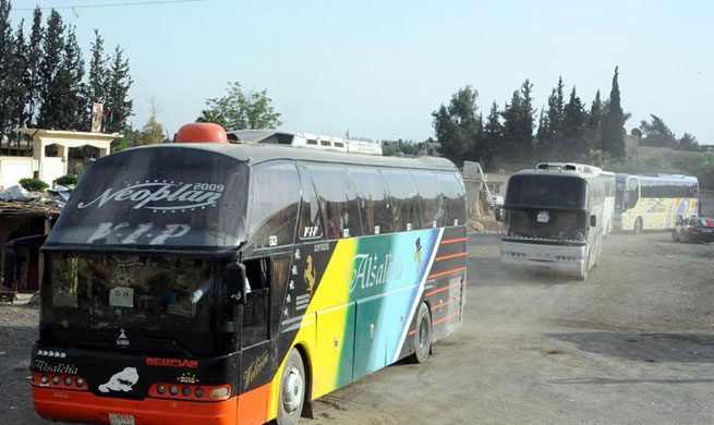 Rebels evacuate from Damascus' Douma as chemical weapons investigators expected