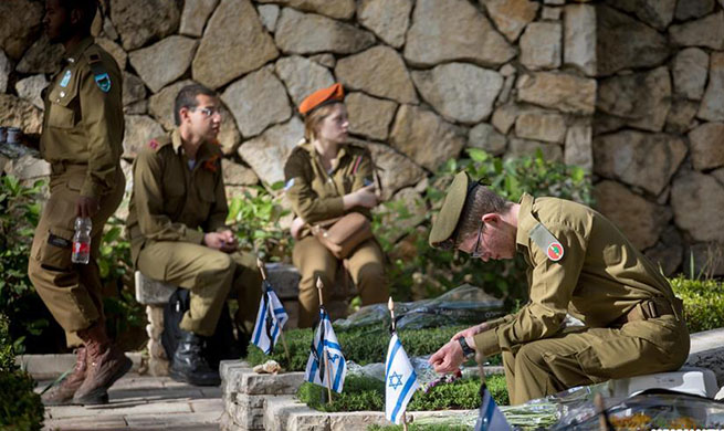 People mark Memorial Day to commemorate Israel's fallen soldiers and victims