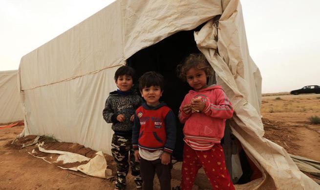 Syrian refugees at settlement in Mafraq, Jordan