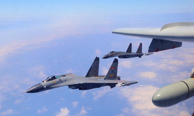 In pics: Chinese PLA air force conducts island patrol training