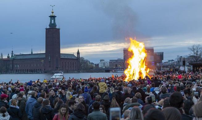 Swedes gather around bonfire to celebrate Valborg in Stockholm