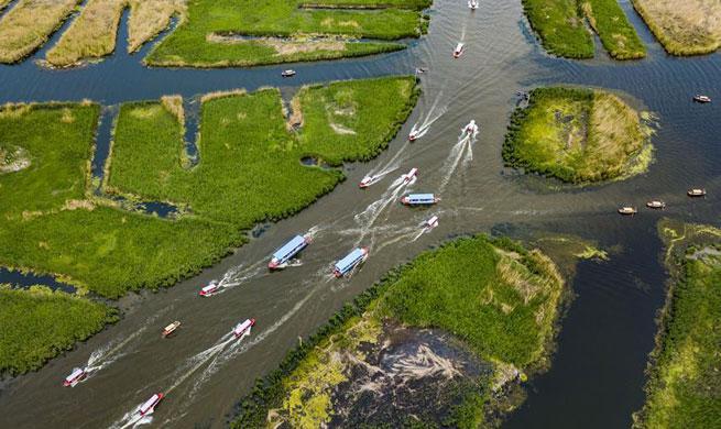 Tourists visit Baiyangdian lake in Xiongan New Area during May Day holiday
