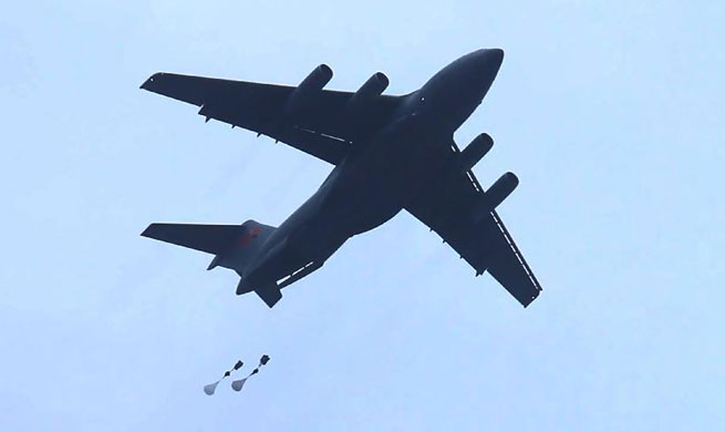 Y-20 heavy transport aircraft conducts first airborne, air delivery training