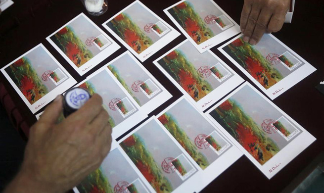 "Stamps and postcards of Lebanese artist Daher's painting ""Sunset"" launched in Beirut"