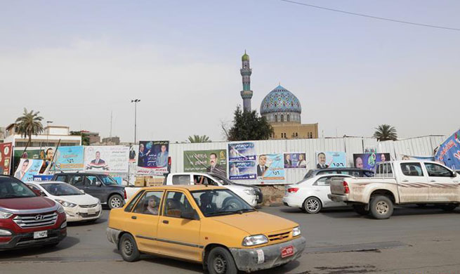 Feature: Iraqis pin hopes on elections to fight corruption, improve governance