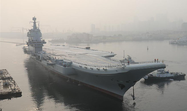 China's first domestically-built aircraft carrier sets out for sea trials