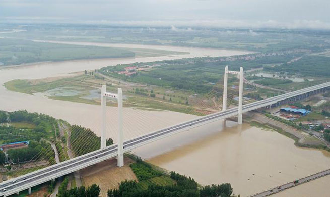 Qihe Yellow River Bridge put into operation in E China's Shandong