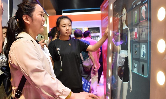 Visitors experience face recognition technology at 2nd World Intelligence Congress