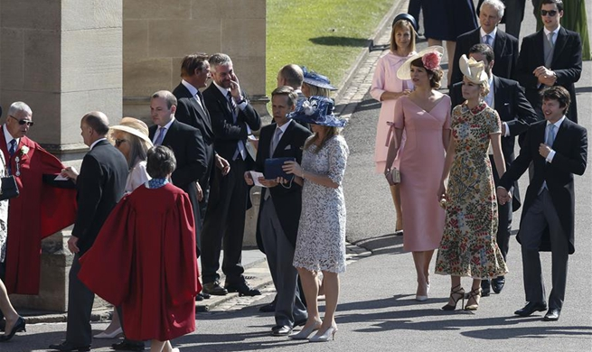Guests arrive at Windsor Castle for royal wedding in Britain