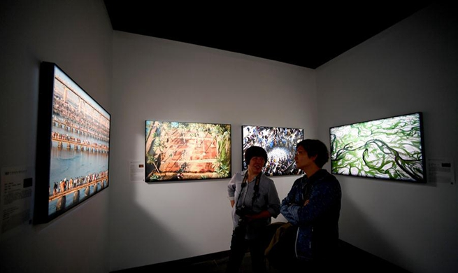 Int'l photo exhibition opens in central China