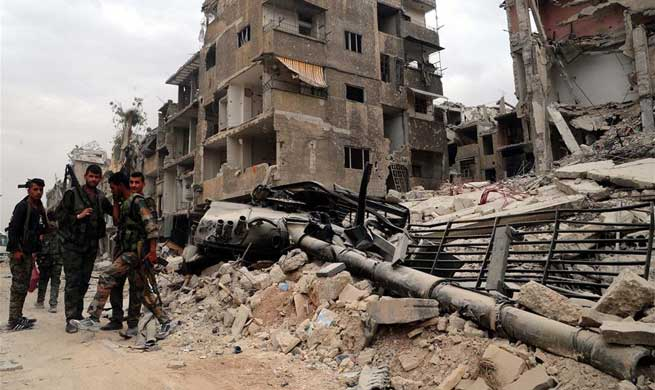 IS militants resort to suicide bombings before defeat in southern Damascus