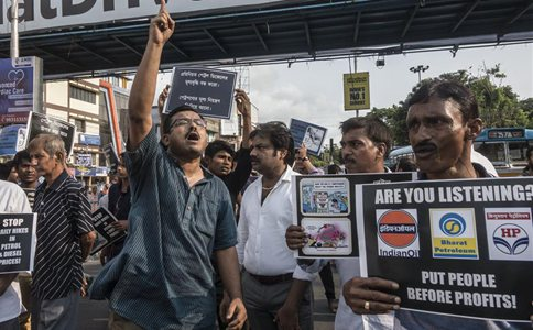 People protest against recent price hike of fuel in Kolkata, India