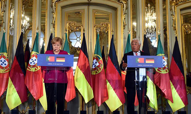 German, Portuguese leaders promise united European response to U.S. trade tariffs