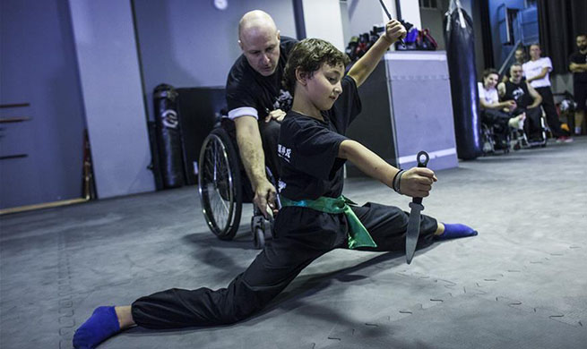 In pics: Wushu teacher in wheelchair in Greece