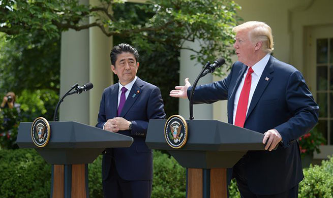 Trump, Abe attend joint press briefing at White House