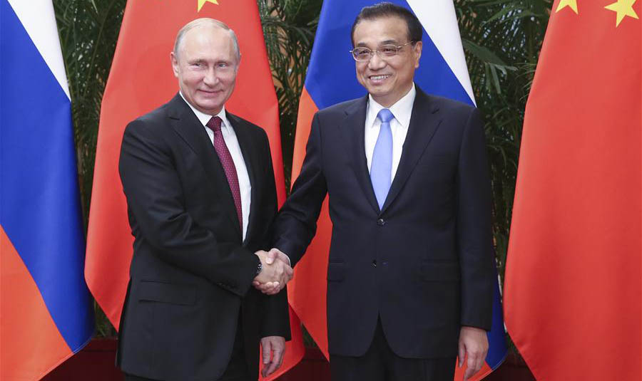 Premier Li meets Putin on closer economic ties