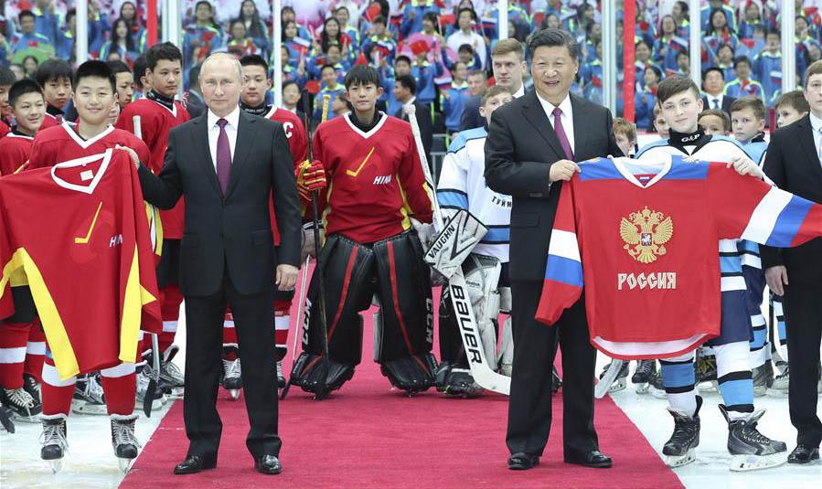 Xi, Putin watch ice hockey match