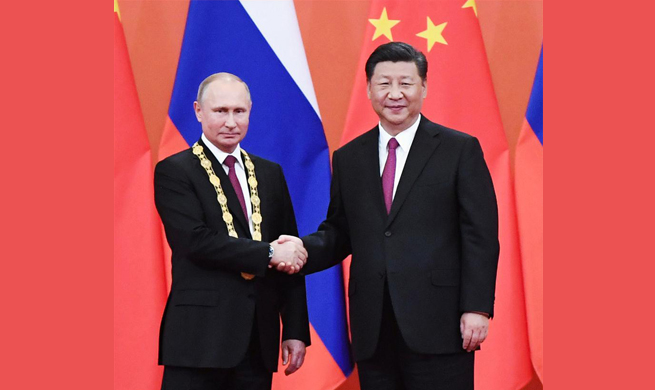 Xi awards Putin China's first friendship medal
