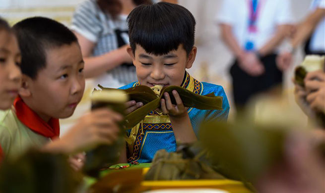 Folk custom activity held to greet Dragon Boat Festival in Hohhot, north China