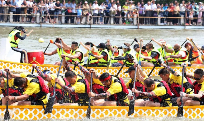 People take part in dragon boat races across China