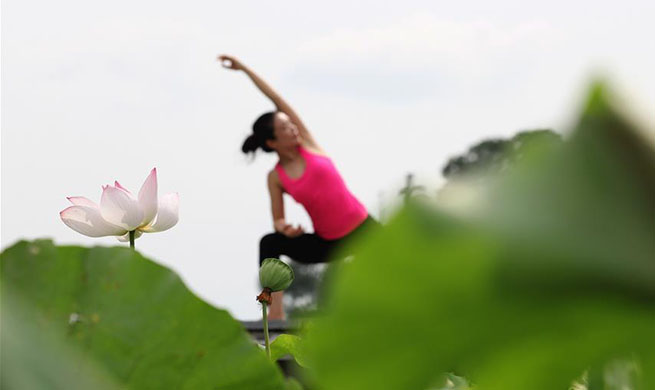 Int'l Yoga Day marked in China