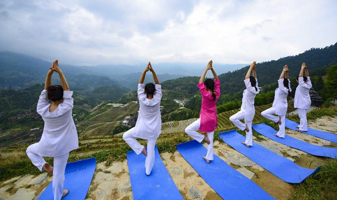 International Yoga Day marked in China