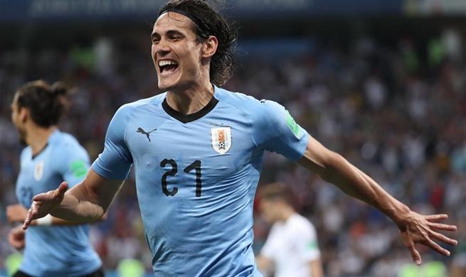Cavani scores twice to send Uruguay to the last eight