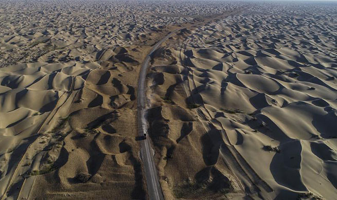 Third desert road under construction in Taklimakan desert in NW China's Xinjiang