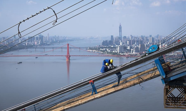Bridge crossing Yangtze River under construction in Wuhan