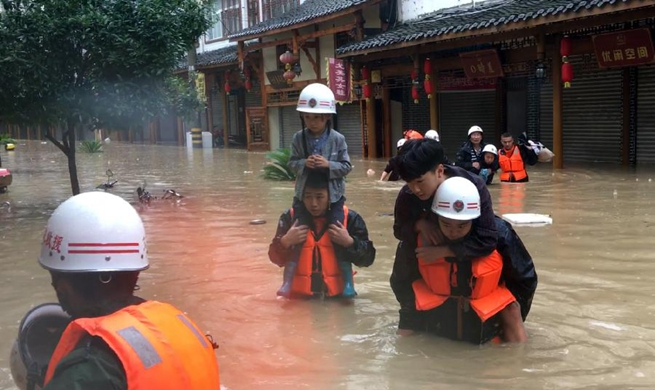 Rescuers evacuate residents as heavy rain hits NW China's Gansu