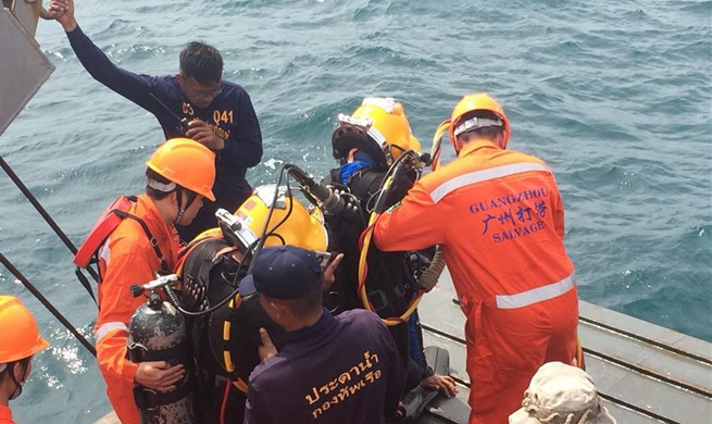 Thai and Chinese rescue team search for body trapped by wreckage in Phuket, Thailand
